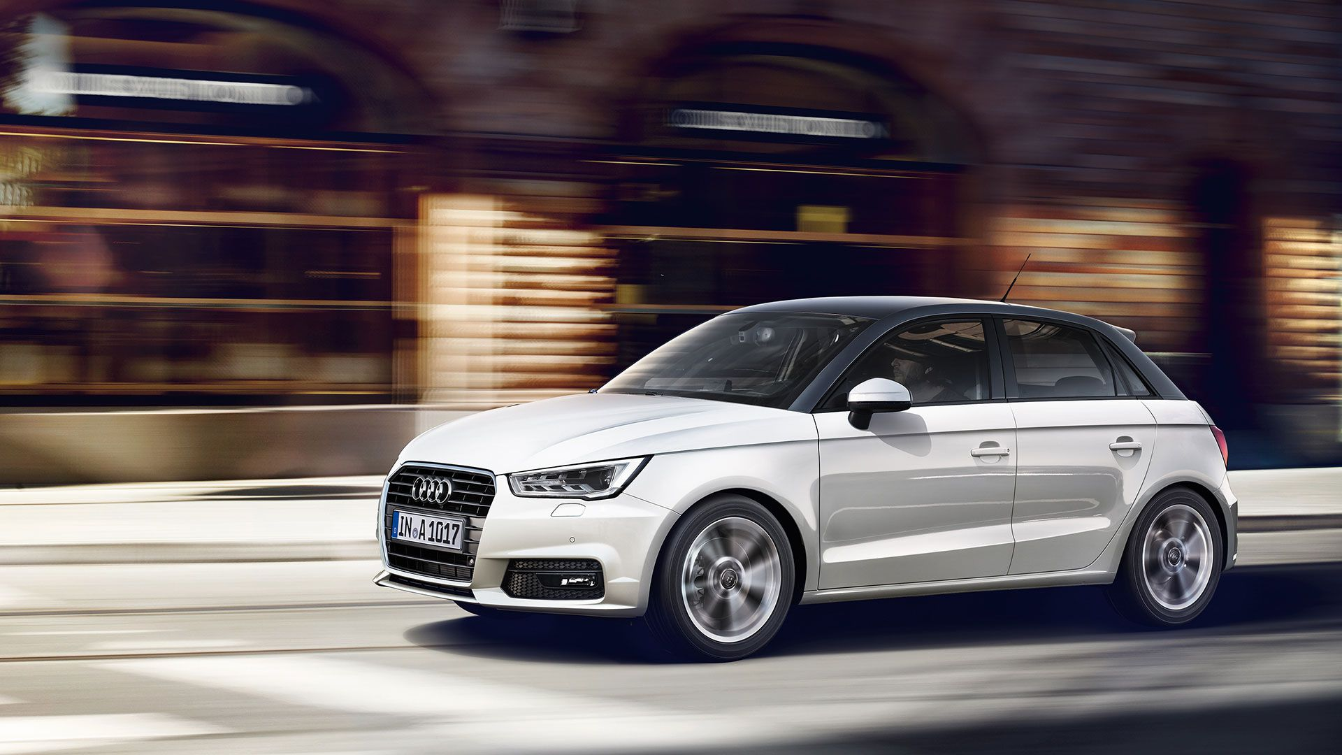 White Audi A1 sportback going at speed