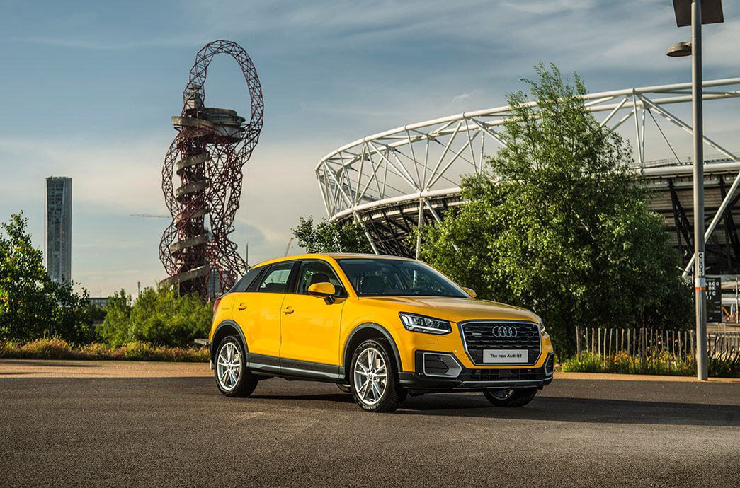 Bright yellow Audi Q2 against Olympic Park backdrop