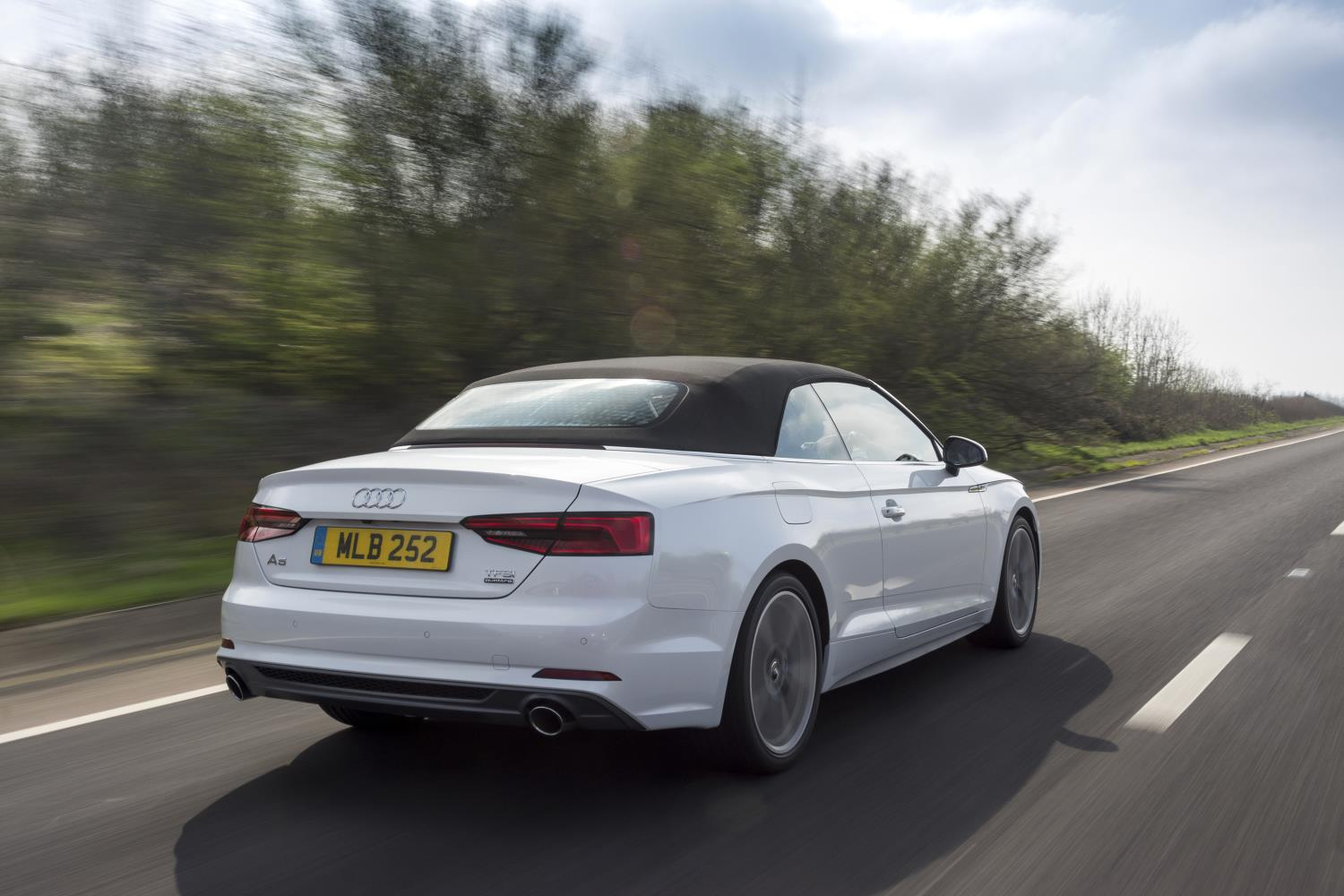 White Audi A5 Cabriolet driving away from you on an open road