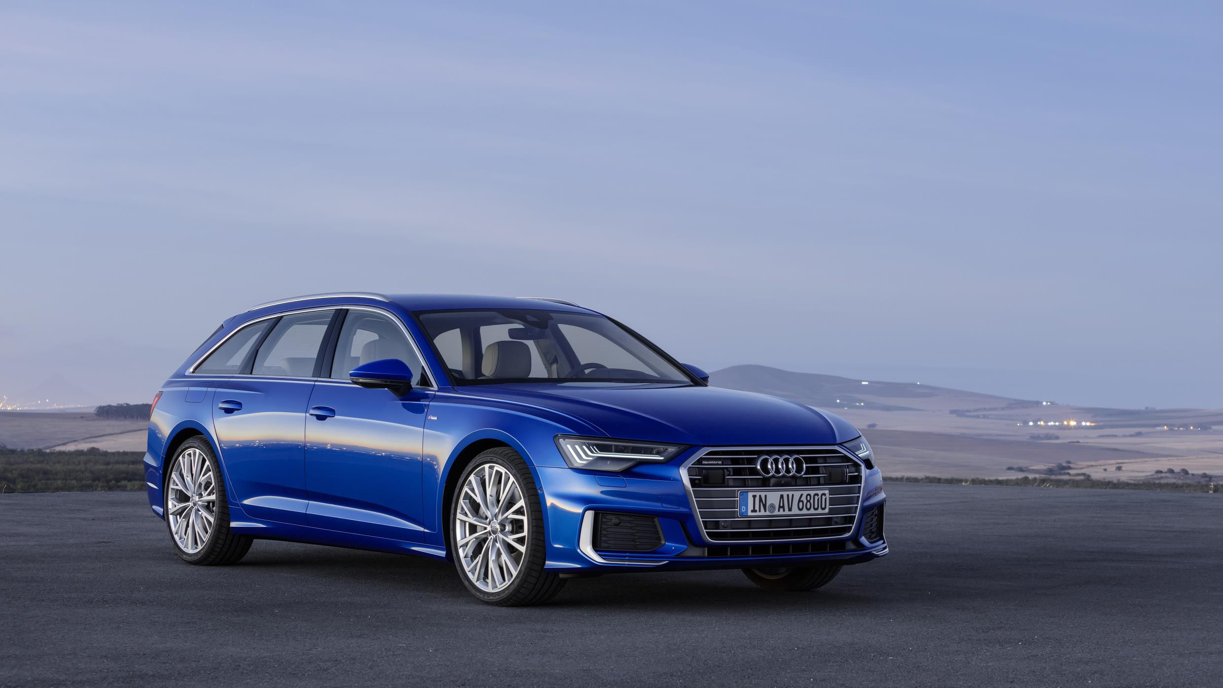 Bright cobalt blue Audi A6 Avant stationary with long distance vista