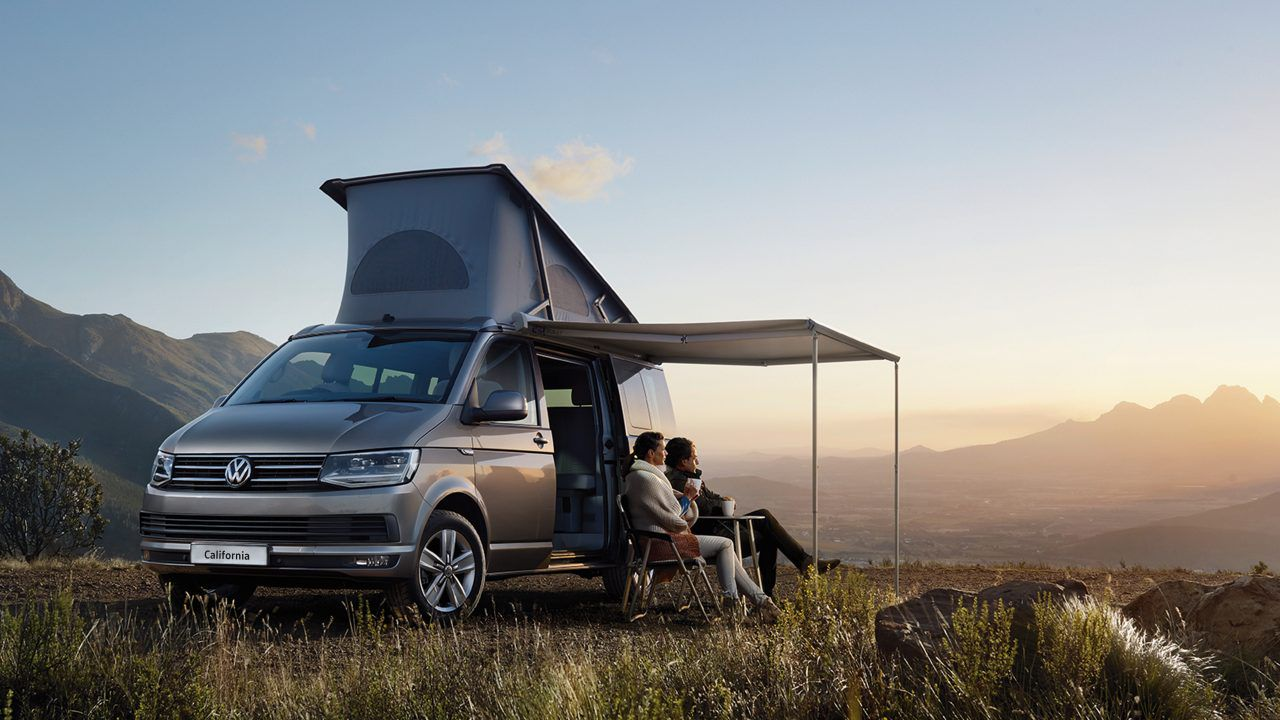 Beautiful backdrop with Volkswagen California campervan and awning and chairs