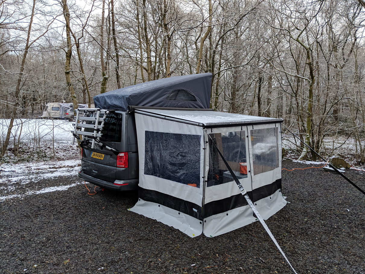 VW California with awning at Lake Coniston in the snow