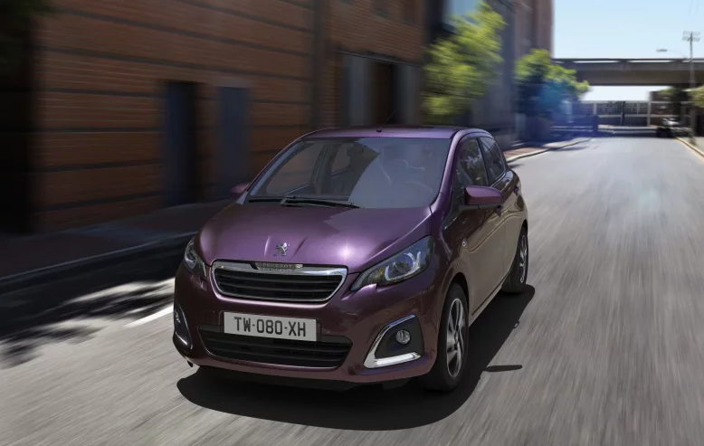 Purple Peugeot 108 5 dr coming towards you on the road