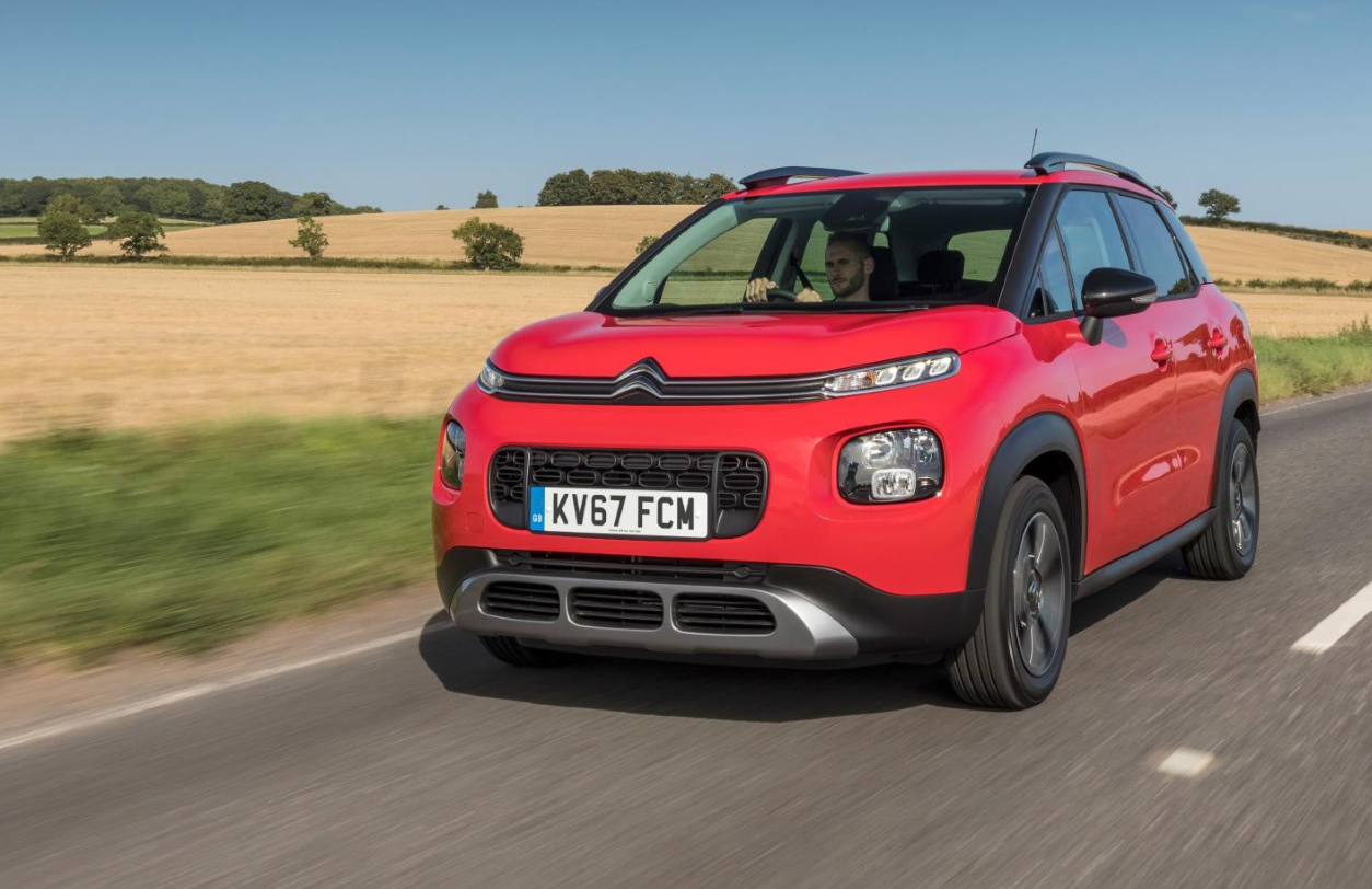 Red Citroen C3 Crossover driving on a country road
