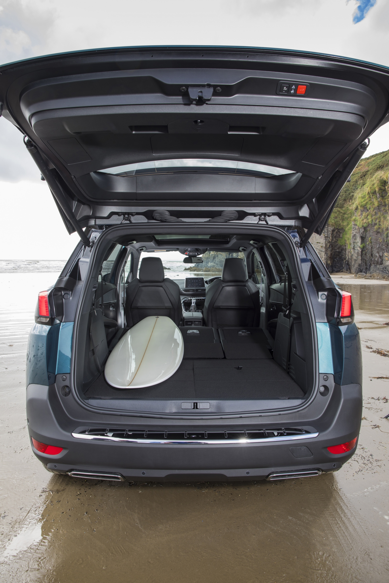 Peugeot 5008 with seats configured to fit a surfboard in