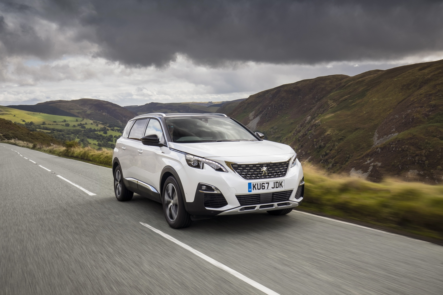 Peugeot 5008 driving towards you on a country road