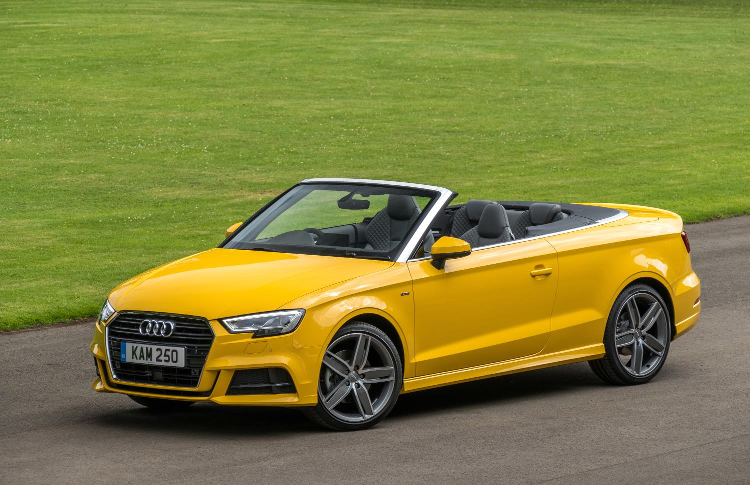 YELLOW USED AUDI A3 CABRIOLET WITH THE ROOF DOWN