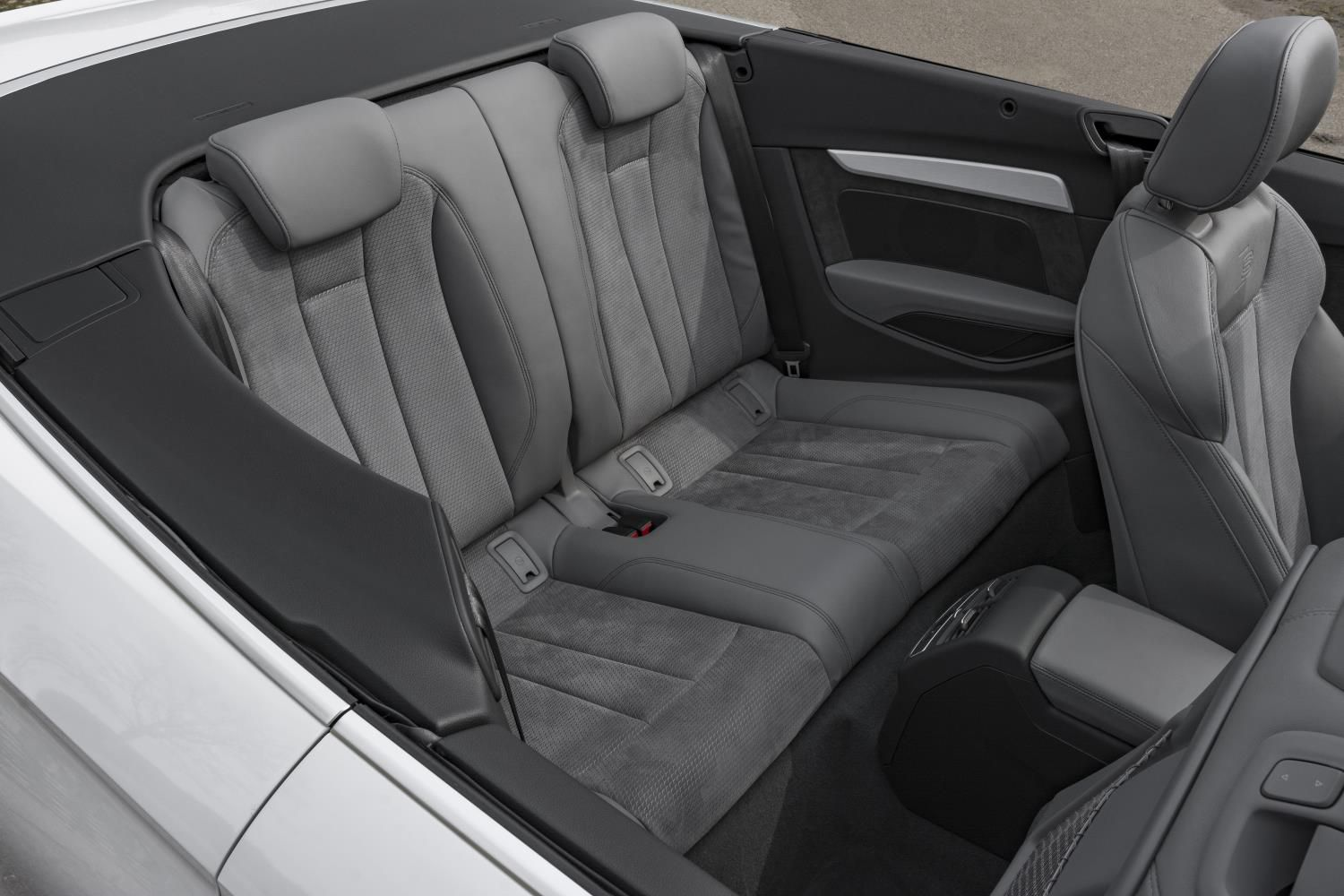 Grey leather rear seats in a white Audi A5 Cabriolet with the roof down