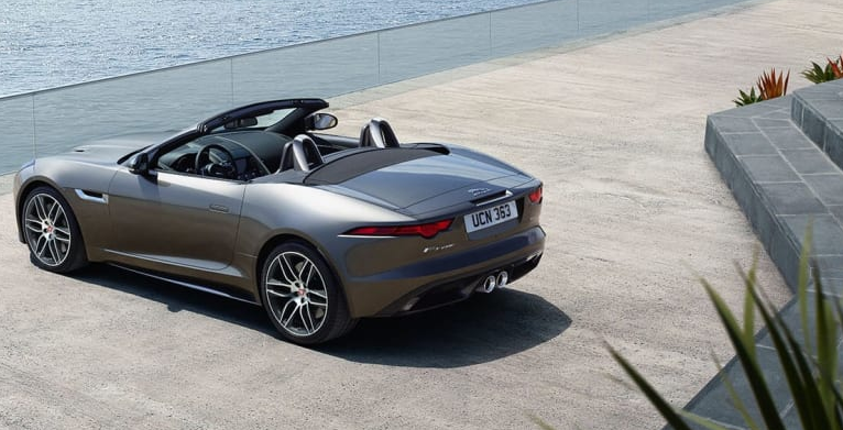 Silver Jaguar F-Type parked up and looking out to sea