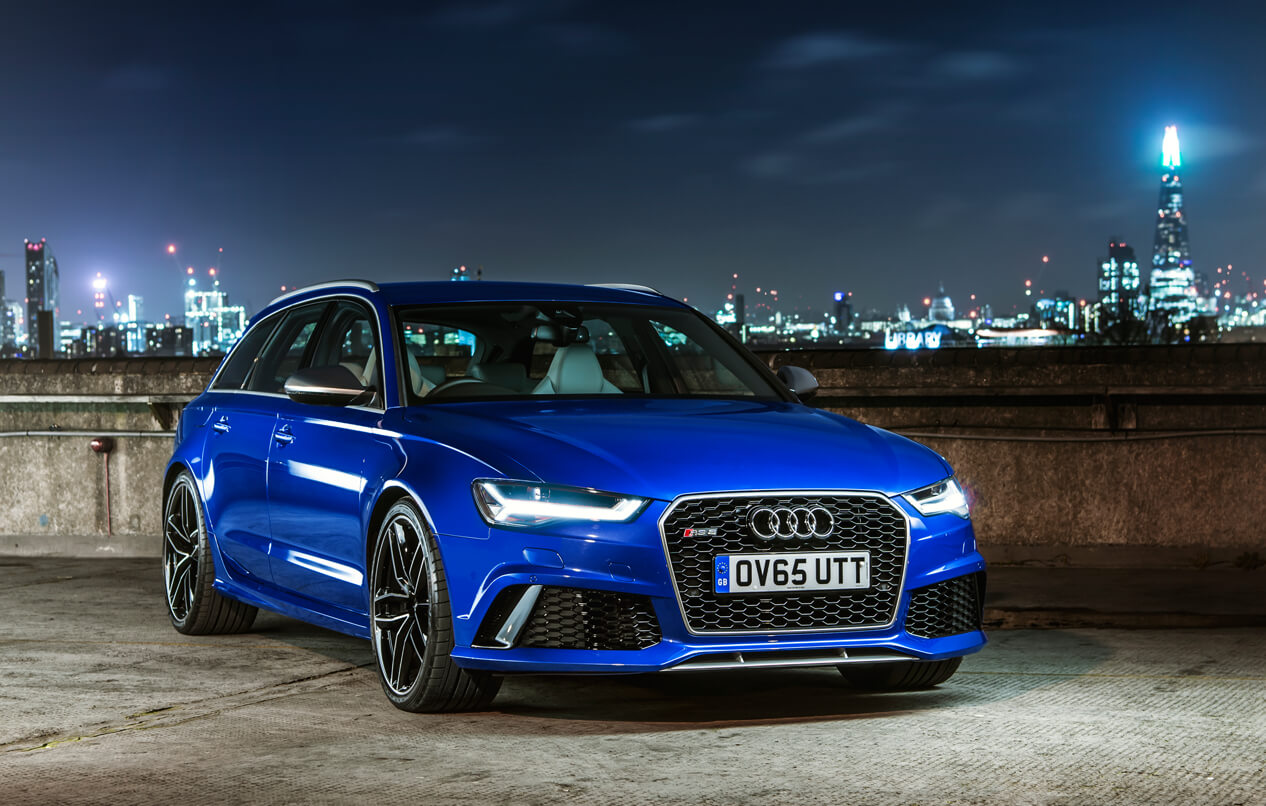 Audi RS 6 Avant against a nigh time city skyline