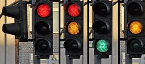 Lots of traffic lights on red amber and green