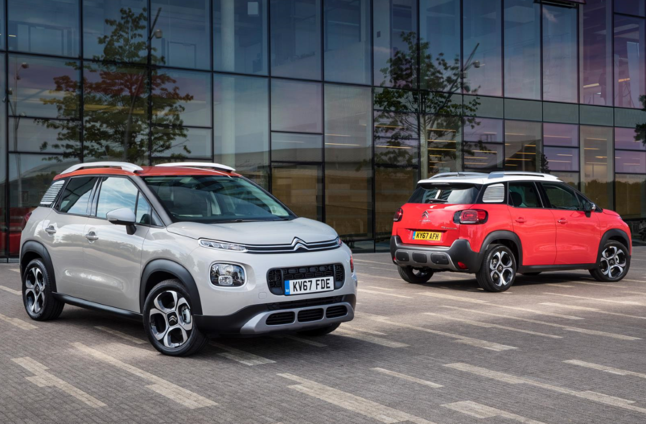 Two Citroën C3 Aircross cars outside office building